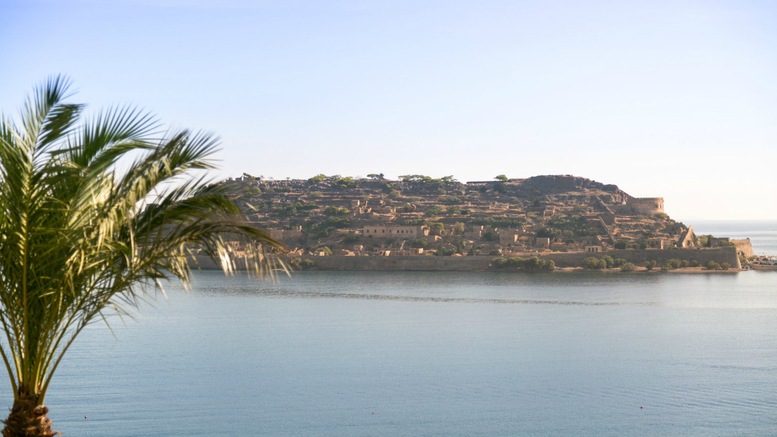 The island of Spinalonga, Elounda, Crete, Greece across Blue Palace resort and spa